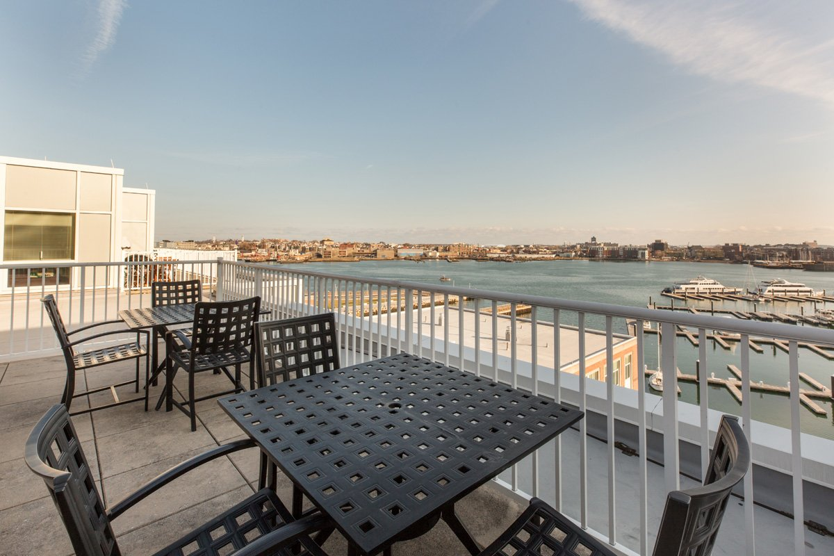Harbor View At The Navy Yard - Rooftop Terrace with Chairs and Square Tables